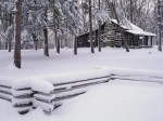 Rail fence and rustic cabin in winter, Brown County State Park, Indiana